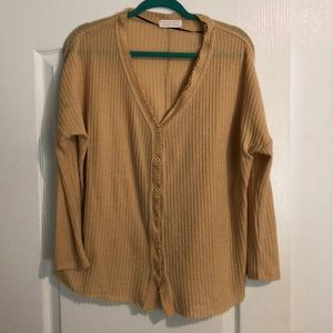 Tan long sleeved shirt